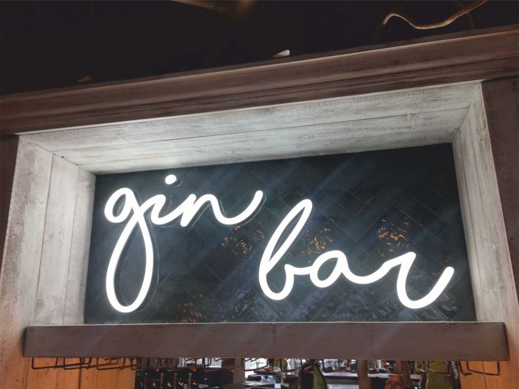 Portland LIghtings Faux Neon illuminated lettering manufactured as joined up lighting for a gin bar