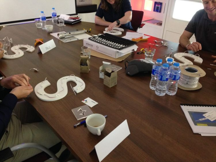 Internally lit built up letters being put together in a training session.