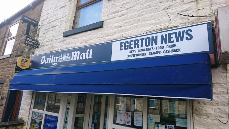 The front of a newsagent shop in Egerton, where the signage has been recently updated by Signs Express