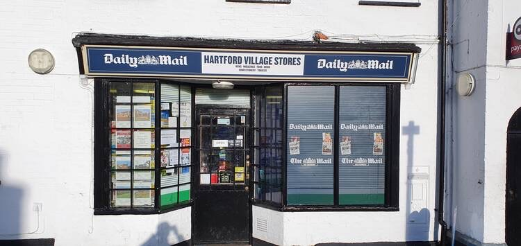The front of a newsagent shop in Hartford, where the signage has been recently updated by Signs Express