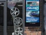 FASTSIGNS digital sign outside of a car shop