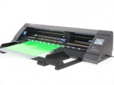 Graphtec lite 50 digital cutter cutting out a green paper