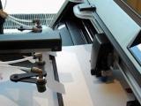 F Mark automatic digital die cutting machine cutting something