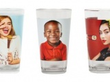 Photorealistic images on cups being displayed