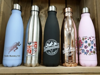 Bottles with full colour designs applied using a traditional mug press and the established CPM transfer paper