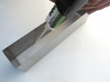 Novaweld SignFix 5 - 2 part adhesive being applied to a built up letter
