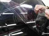 3M's 2080 gloss film been applied and the protective layer being removed from a sports car.