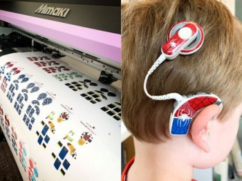Printer and hearing aid with freshly printed graphics on it.