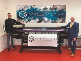Park Graphics' Garry Walshe (left) with the Waterford-based business' new Mimaki CJV300 purchased through Bernard Hoey of GMPI (right)
