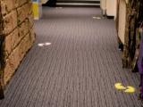 Floor graphics in a corridor at school