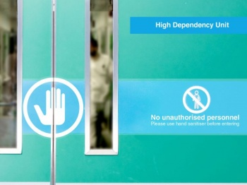 Door in a hospital with printed signage applied.