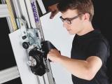 Man cutting aluminium composite using Keencut's SteelTrak