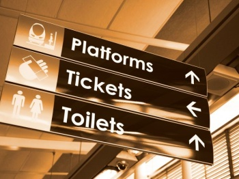 Directional signage showing directions in a station