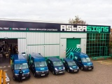 Aerial photo of the outside of Astra Signs premises with 5 of their vans outside.
