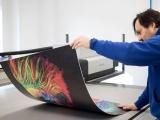 A swissQprint Impala 3 UV LED flatbed printer