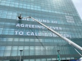 Huge PVC-free vinyl being applied to the National Footbal Museum