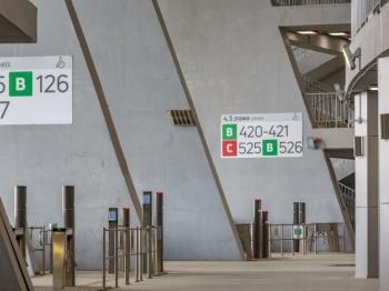 Football stadium with signage on pillars