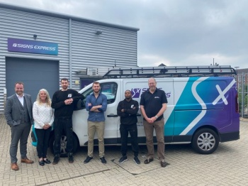 The team at Signs Express (Twickenham) standing in front of a Signs Express van.