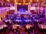 UK Graphics Awards evening event with lots of people present sitting around tables watching the presentations