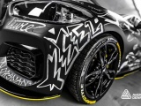 Sports car wrapped with printed graphics